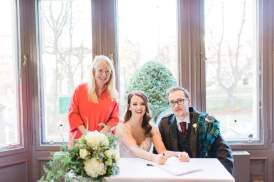 Kirsty and Adam sign on the dotted line at Devonshire Gardens.